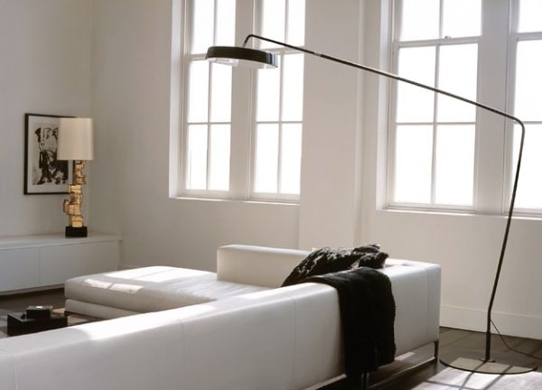 Sectional sofa in white with a low back and a floor lamp above for light