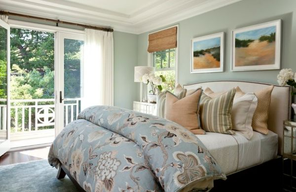 Serene and stylish bedroom in relaxing hues with woven wood shades