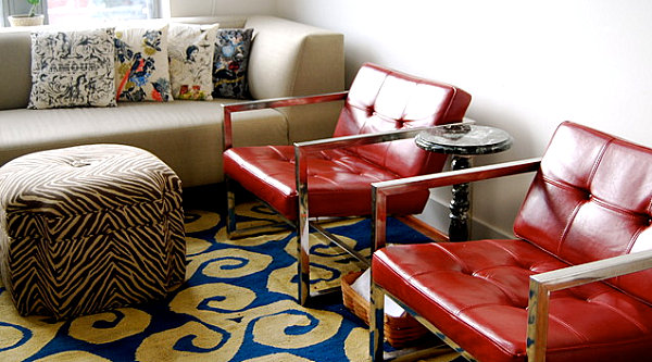 Shiny red chairs in a modern eclectic living room
