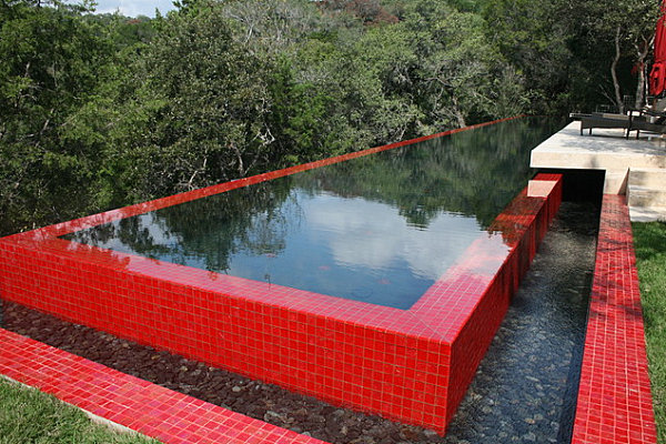 Shiny red tile around a modern outdoor pool