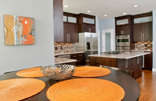Simple additions like wall art and dining table mats can bring in orange accents