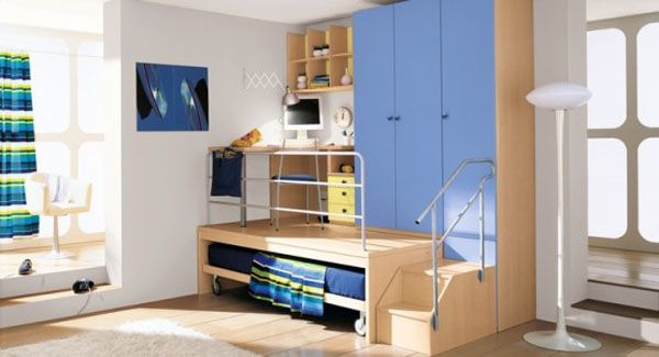 Sleek and ergonomic boys' bedroom that incorporates several blue hues