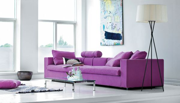 Sometimes all you need is a couch in purple to liven up a bland setting!