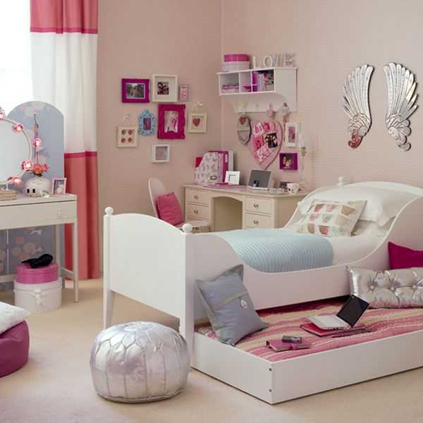 Sophisticated girls' bedroom sports a couple of shiny surfaces to bring in the chic appeal