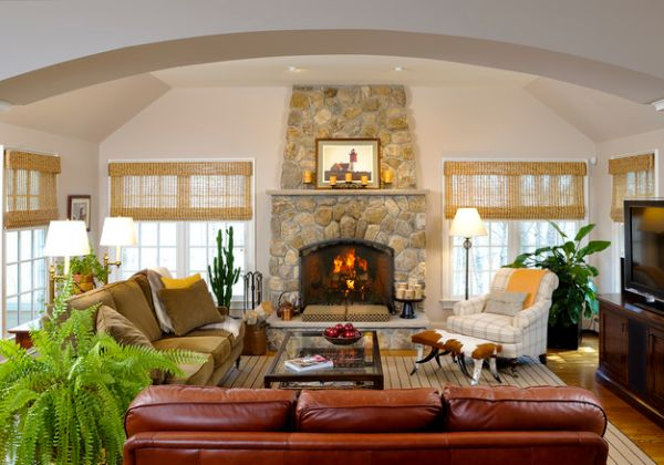 Stone fireplace and woven wood blinds create a classic and timeless look