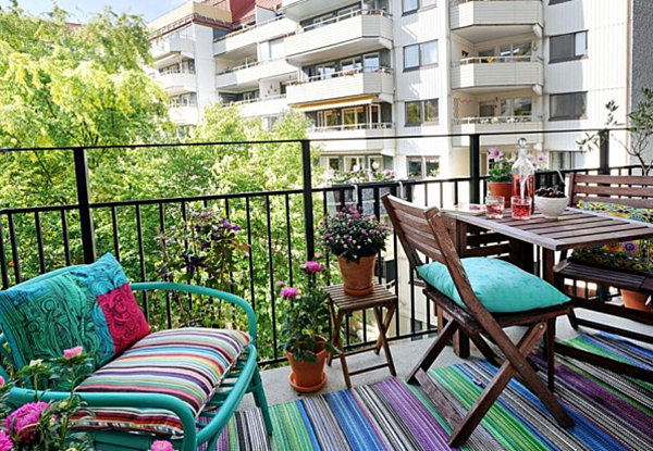 Striped textiles on a small balcony