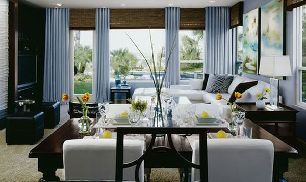 Stunning contemporary living room with gorgeous drapes coupled with bamboo blinds