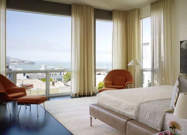 Stunning modern bedroom with a view sports a stylish and vintage floor lamp