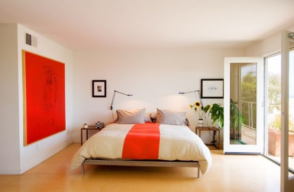 Wall art brings in a powerful punch of orange to this gorgeous bedroom