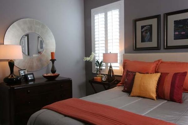 Warm and inviting bedroom in grey with orange accents