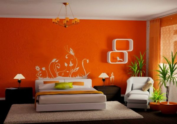 White and orange bedroom with bursts of green
