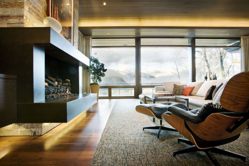 living room with eames chairs and fireplace