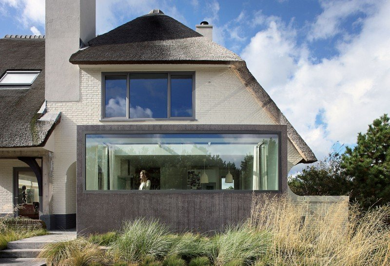 modern beach home with thached roof
