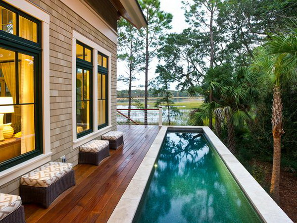 modern wooden deck with pool
