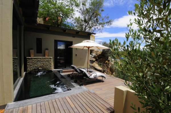 outdoor deck with lap pool Natural Textures Meet Contemporary Interiors At The Olive Exclusive Hotel In Namibia