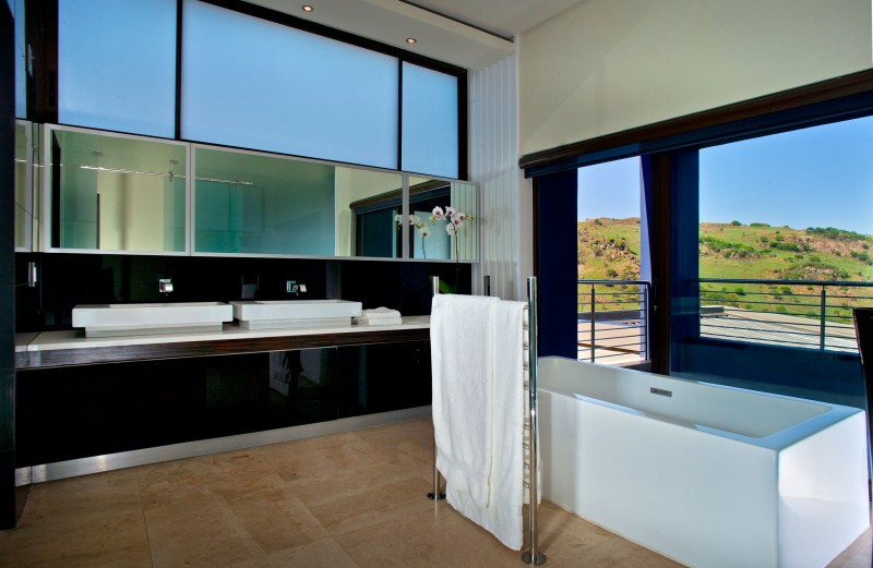 Stunning lighting and stylish interiors grace house tat in for Modern bathrooms south africa