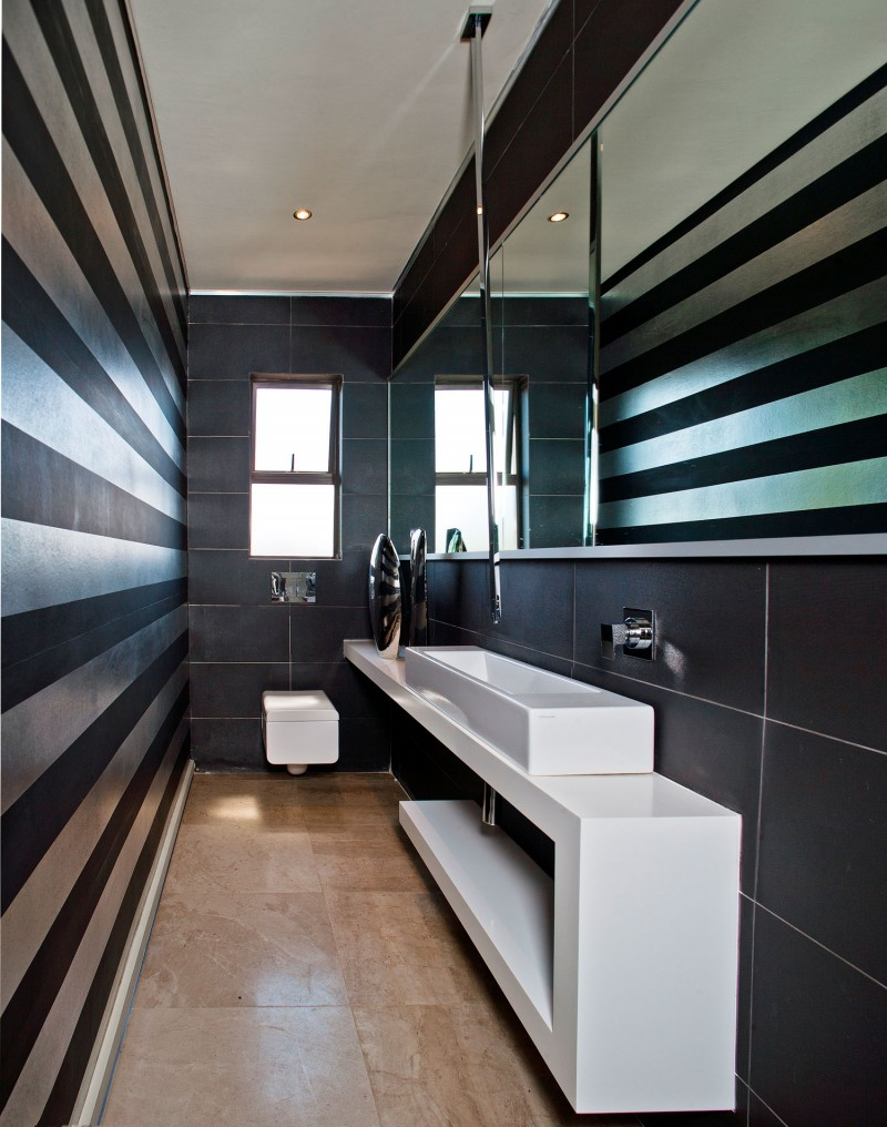 small bathroom with stripes on walls