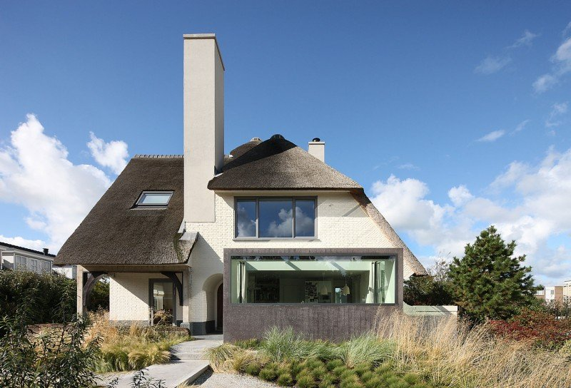 thatched roof Rustic Dutch Seaside Residence Gets a Modern Makeover Capped With a Thatched Top