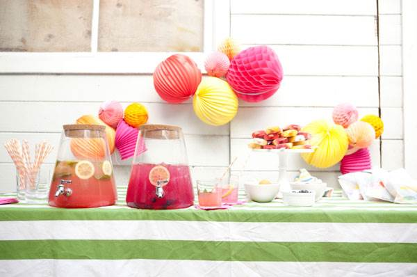 Crepe paper balls and other summer party decorations 12 Tips for Hosting a Summer Party