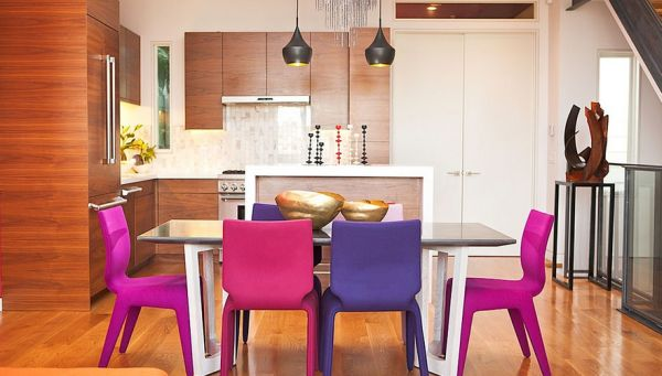Dining space with chairs in fuchsia and violet add color to contemporary style