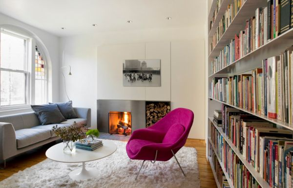 Eero Saarinen's Womb Chair in Fuchsia acts as an accent chair in a neutral setting
