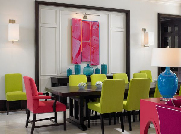 Exquisite dining space laced with fuchsia, turquoise and lime green