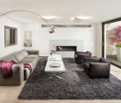 Exquisite living room in white and grey with the Arco floor lamp