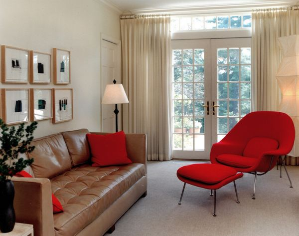 Family room acquires dazzling charm with the womb chair in vivacious red