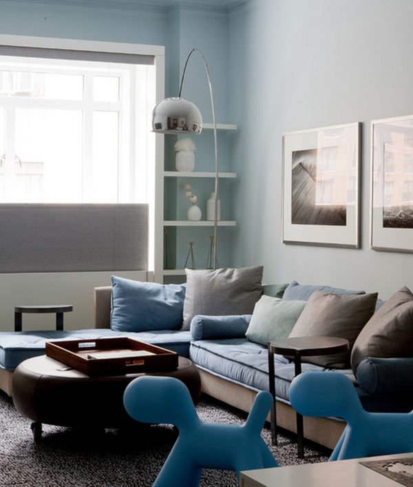 Family room in light blue with Arco floor lamp set in a corner