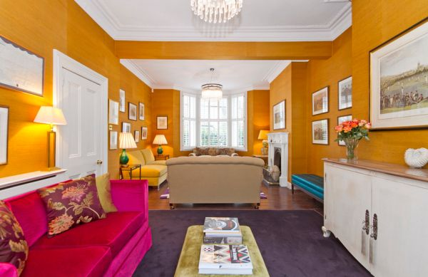 Fuchsia and tiger eye orange give this family room an inimitable look!