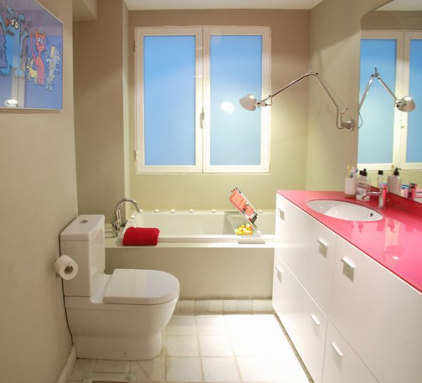 Girls' bathroom with countertop made of gorgeous fuchsia glass