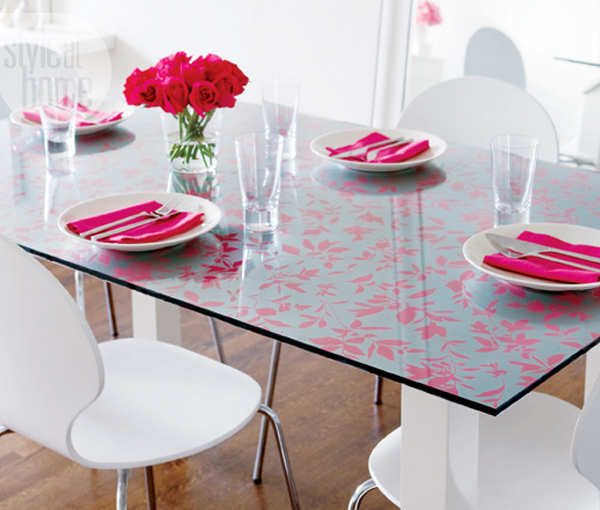 Glass dining room table with wallpaper top