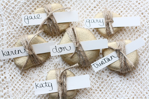 Golden rock place card wrapped with twine