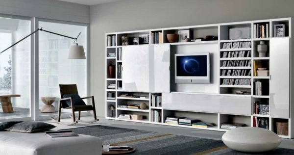 Gray presents a natural contrast to white shelves in the family room