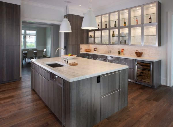 Green – gray cabinets light up this compact kitchen in a open floor plan