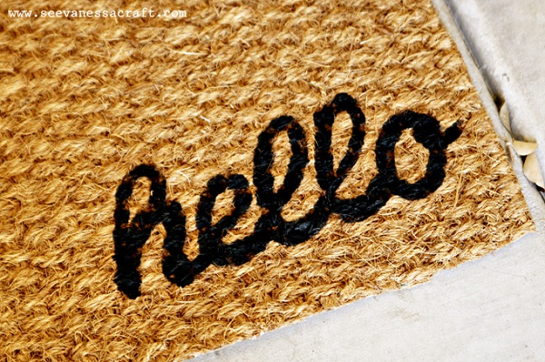 Hello woven welcome mat
