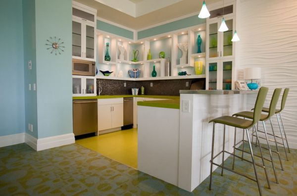 Kitchen floor, counters and glassware collection complement each other beautifully