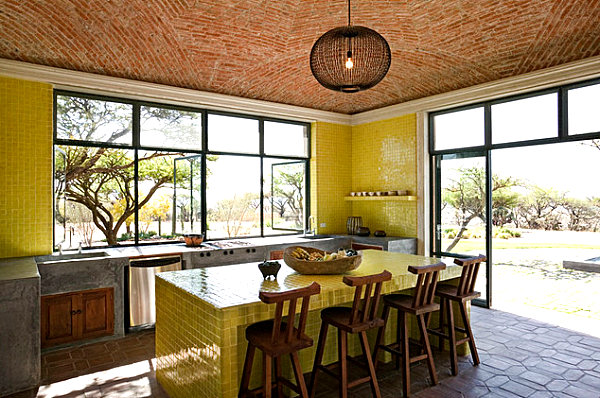 Kitchen with yellow tile accents