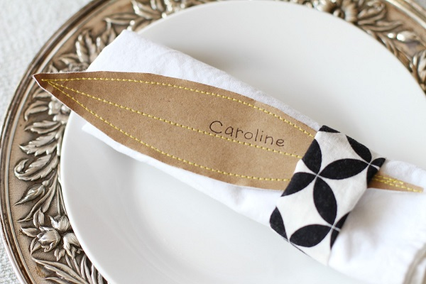 Leaf shaped place card with napkin holder