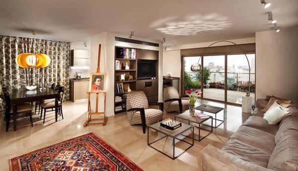 Lovely eclectic living room in earthen tones with the Arco