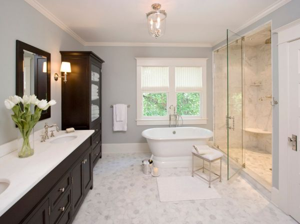 Master bathroom sports a relaxed atmosphere thanks to the midtone gray on the walls