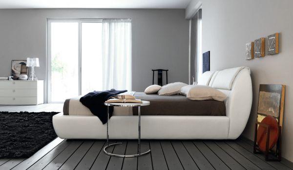 Minimalist bedroom in bluish gray with matching flooring