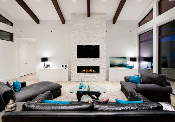 Minimalist living room in black and white with turquoise cushion accents