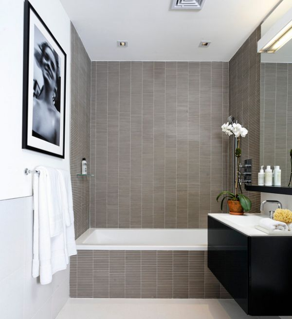 Modern bathroom in white with a neatly placed black and white print