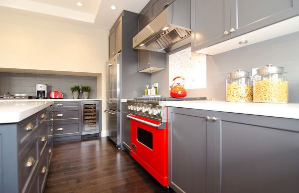 Modern kitchen with gray cabinets and a dash of red