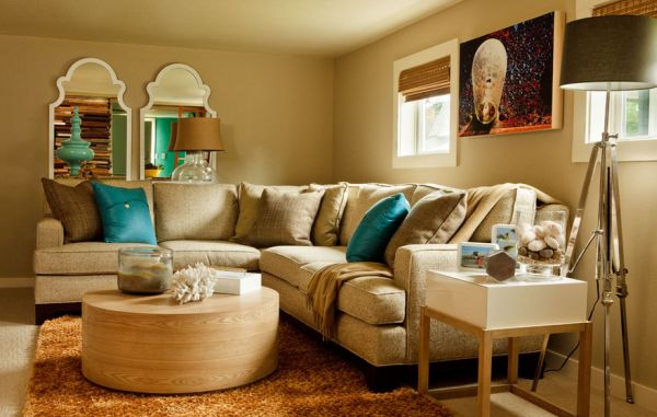 Ocean blue pillows provide cool seaside charm in a neutral living room with earthen tones