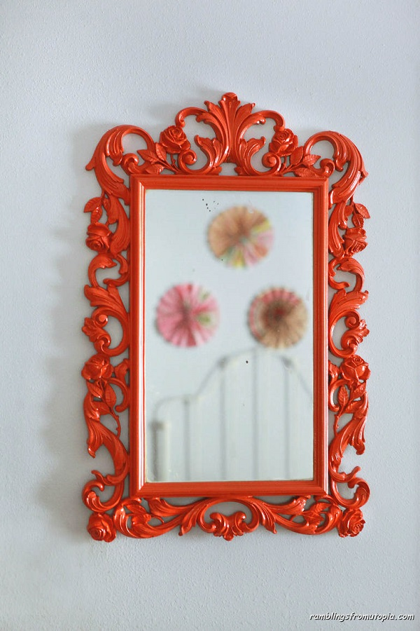 Ornate bright orange painted frame