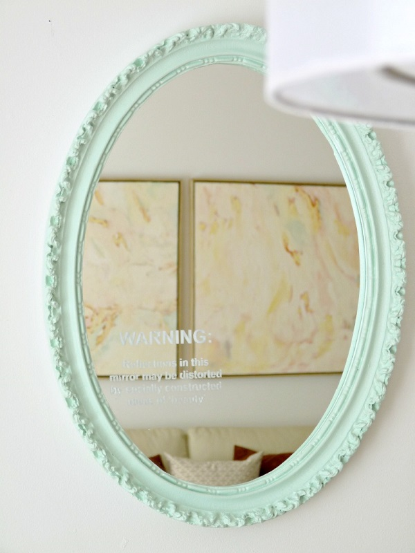 Pastel blue painted mirror frame with delicate details