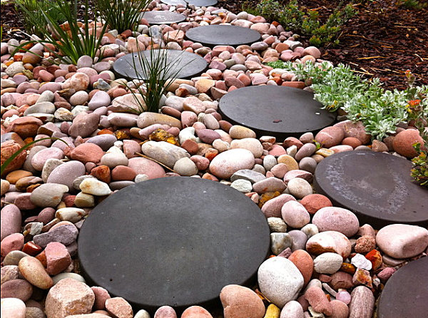 Pebbles and modern stepping stones on a pathway