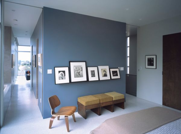 Picture ledge with black and white photos creates an elegant focal point in a bright room